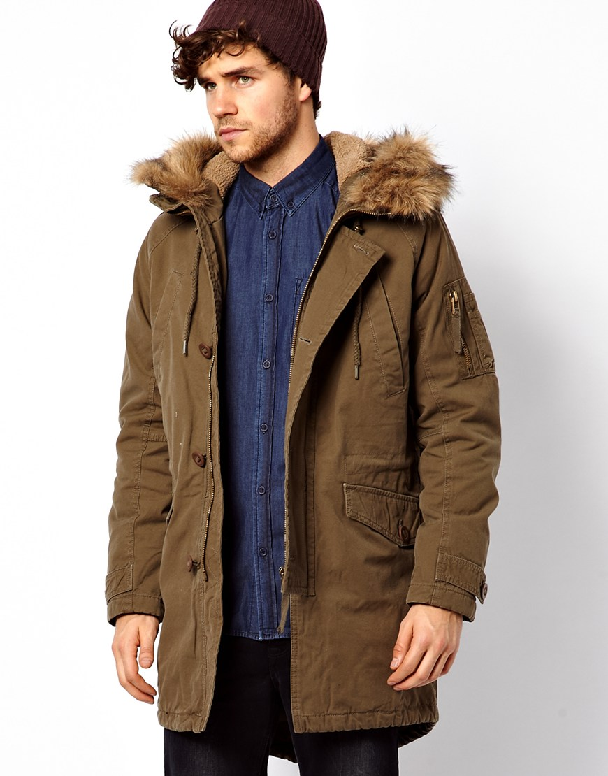 Strictly speaking, an anorak is a waterproof, hooded, pull-over jacket without a front opening, and sometimes drawstrings at the waist and cuffs, and a parka is a hip-length cold-weather coat, typically stuffed with down or very warm synthetic fiber, and with a fur-lined hood.