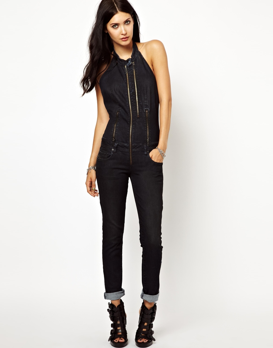 A classic jumpsuit is a chic alternative to typical women's dresses, so you can enjoy greater freedom of movement in fashion-forward cuts and styles. Try an all-black jumpsuit to .