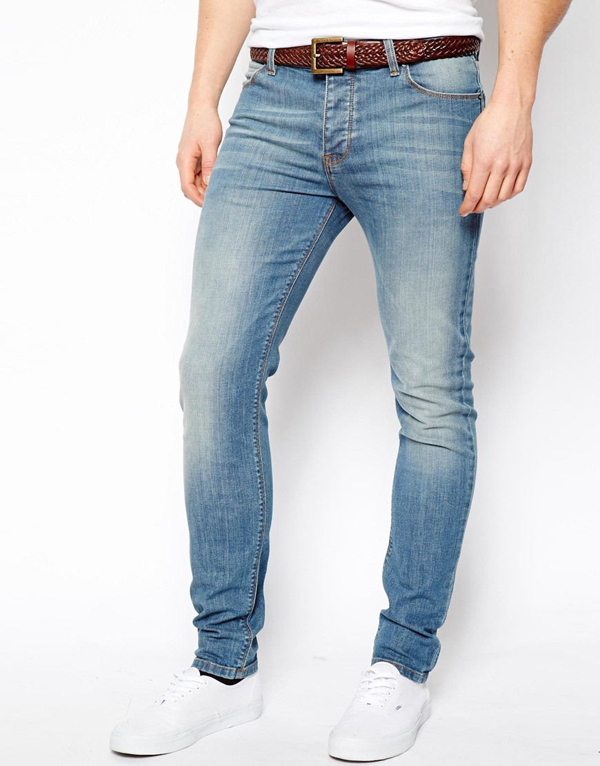 Light blue denim Skinny fit Ripped detailing Five pockets Belt loops Button up fastening Our model wears a UK 32 regular and is cm/6''' tall. Men. Jeans. Levi's light blue ripped skinny jeans Levi's light blue ripped skinny jeans £ Product no.