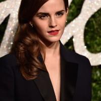 Emma Watson in a Misha Nonoo Jumpsuit & Dior Coat